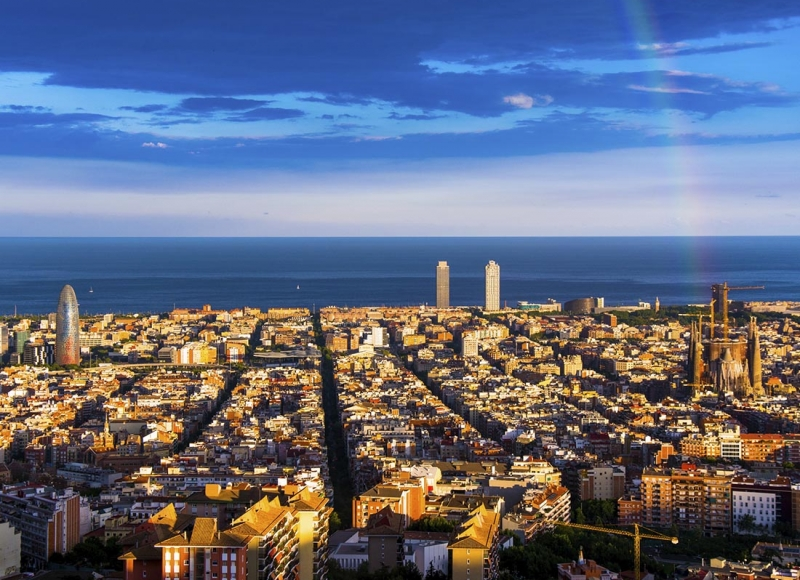 rainbow and barcelona skyline