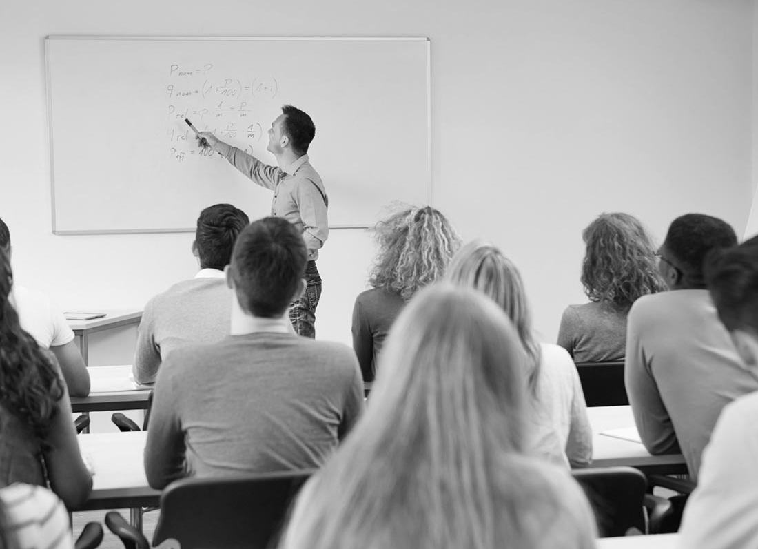 Students listening to teacher in class on a whiteboard; Shutterstock ID 133805591; PO: aol; Job: production; Client: drone